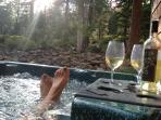 Enjoying a glass of wine in the hot tub overlooking the forest - incredibly peaceful!