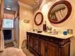Bathroom with double sink and washer dryer