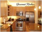 Fully Equipped Gourmet Kitchen With Granite Counters & Stainless Steel Appliances