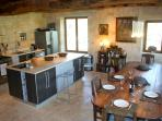 Kitchen is 36sqm. 3 meters long dining table seats 12 comfortably