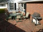 Brick Patio and BBQ, with Bocce Yard and Courtyard Room windows in background
