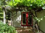 The grape filled arbor off the dining room