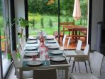 Dining room and terrace - wood stove L'Etoile des Glaciers