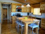 Kitchen and dining table - gas stove, oven and full kitchen utilities