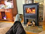 Relax on the chaise lounger in front of the new wood stove