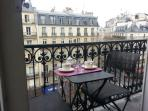 Balcony with a table and 2 chairs