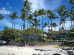 Our sandy sunning beach, Ali'i Drive and Kona Islander Condos
