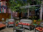 Private back yard with deck, chaises, gardens, and gas grill