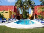 Large gardens surround pool and Jazuzzi