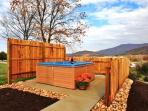 Private Hot Tubs With Mountain Views at each cabin.