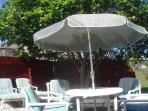Even in winter you can relax & enjoy the sun or meals in the secluded yard under the citrus tree