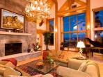 Great Room with 20 ft fireplace, 30 ft ceilings, and grand piano