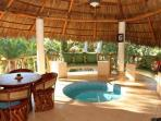 Under the PALAPA is a dipping pool and a marvelous place to sit  and chat