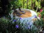 The garden is punctuated by special spots.  Here is a sitting area that converts to a fire pit.