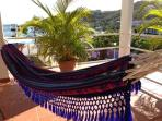 Relax and enjoy the sea views and a siesta in our hammocks in the spacious airy deck.