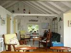 Living room and dining area at Jollimore Lane Cottage
