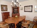 This formal dining room seats 8 comfortably and is tastefully decorated with nautical memorabilia.