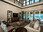 Lower livingroom with spectacular views and 2 storey ceiling