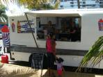On weekends, Playa Azul has several food trucks parked at the beach.