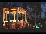 The Gazebo At Night With lighted hot tub below
