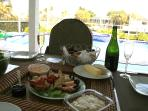 Enjoy the famous Marco Island Stone crabs while  sitting by the pool