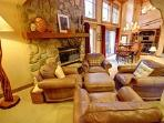 Comfy reading chairs by cozy fireplace