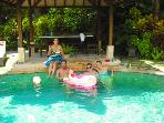 Our guests enjoying our naturally warmed pool