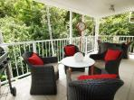 Outdoor barbecue, lounge and dining table on a six metre balcony