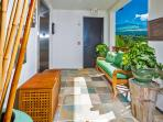 J505 Orient Pacific Suite - Private Elevator Landing for J505 with teak bench, beach towel boxes, and custom decor