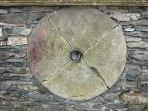 Millstone in wall