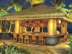 Poolside tiki bar lit at night