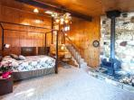 Master Bedroom/Family Room with Wood Stove