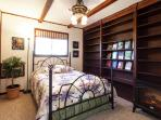 Bedroom with New Full Bed and Books