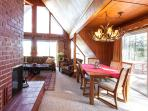 Dining Area by Wrap Around Fireplace & Deck