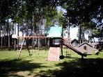 Fun playground equipment with rock climbing wall,slide & swings