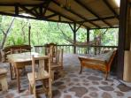 The huge terrace overlooks the river... hand-milled wood indlaid by hand