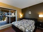 Queen bed and a private hot tub with views of Whistler