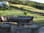 Outdoor Patio Area with Table Benches and Wrap Around Couch
