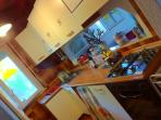 Full Kitchen with Dining Room and Garden View