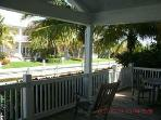 Cool shady porch off living and dining room wtih outside dining and seating