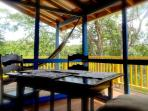 Fully screened-in deck is huge with hammock and dinning table