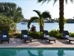 Spectacular Heated Pool Area Offering Breathtaking Unobstructed Water Views..
