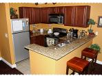 Fully Equipped Kitchen with Breakfast Counter, Fridge, Stove, Microwave, Dishwasher
