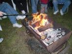 Heron Bay picnic area - Warming by the fire at the October fire and food fest