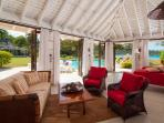 The Cottage living room includes 2 chaise lounges that are actually twin mattress for 2 additional guests, enabling...