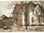 This is a 1930's view of the home, looking northwest to southeast, from Oak St. before guest entry.