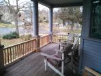 Lovely seating on the wide front porch in all but the worst weather. View from east to west.