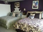 The Purple Room with two Queen Beds, wet bar, mini frig