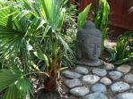 Buddha contemplating the garden