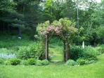 Rose arbor leading to sitting / dining area